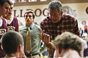 Magnolia West head coach Mike Clifford speaks with his team during a recent game. Magnolia West fell to Caney Creek 46-44 on Dec. 20.