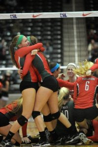 The Woodlands players celebrate their Class 5A state volleyball title.