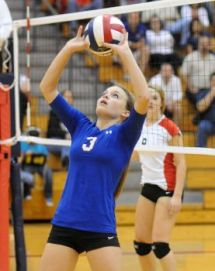 Oak Ridge's Jaclyn Ward sets the ball during the Oak Ridge at The Woodlands volleyball game. Photo by David Hopper