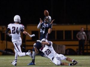 College Park's Greg Maxie with a big catch over Pearland defenders Friday night.