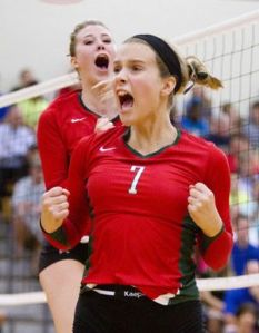 he Woodlands' Hannah Hickman and Rachel Reed celebrate after scoring a point during a high school volleyball game at The Woodlands High School Friday