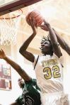Conroe's Tremont Moore (32) is fouled while attempting a layup against Huntsville.