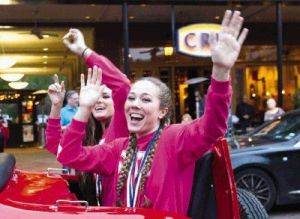 The Woodlands volleyball player Julia Pasch waves to fans during a parade in celebration of the program's second straight state volleyball title at Market Street Thursday.