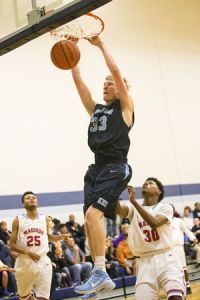 Kingwood's Matt Mulloy (33) dunks during their consolation matchup against Houston Madison in The Insperity Holiday Classic on Dec. 30, 2014, at Kingwood High School.