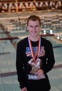Oak Ridge's Austin Hoherz set a school record while winning the District 16-6A diving championship.