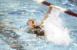 The Woodlands' Lucie Nordmann swimming during the 100-yard backstroke at the UIL Region IV-6A Championships on Saturday. Nordmann set a new school record, and placed first in the competition during the event.