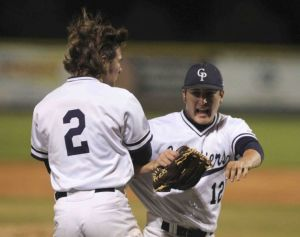 College Park pitcher Beau Ridgeway celebrate after the final out of a District 16-6A baseball game against The Woodladnds Tuesday.
