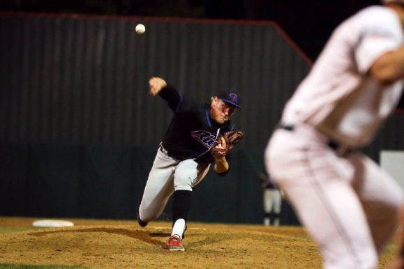 Oak Ridge's Luken Baker (33) throws a pitch during the high school baseball game against The Woodlands.
