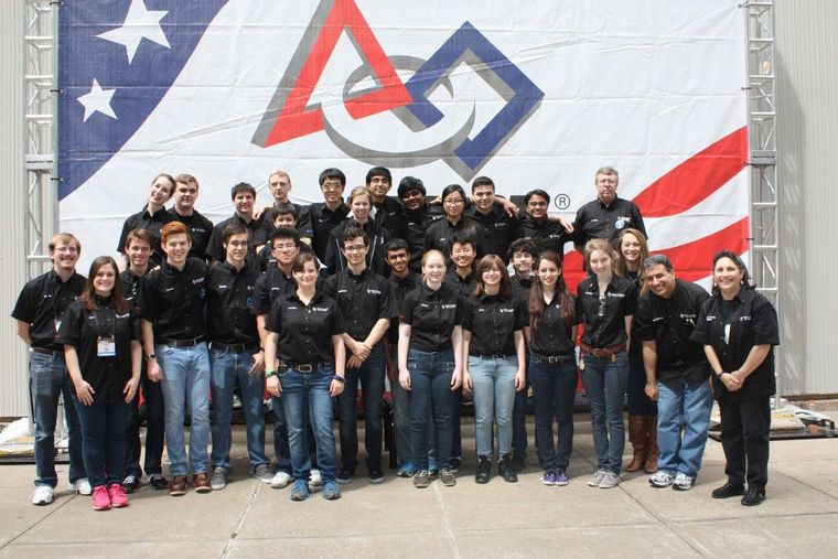 Texas Torque Team 1477 poses at the Edward Jones Dome in St. Louis at the FIRST Robotics World Championship.
