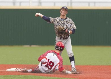 College Park's Aaron Perkins gets Lake Travis' Jared Triolo out as he turns a double play in the sixth inning of a Region III-5A regional semifinal game at in Mumford Thursday.