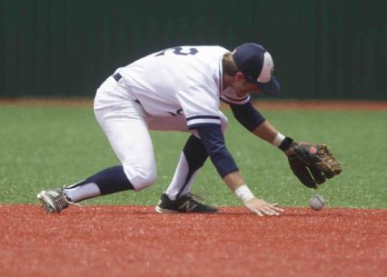 College Park second baseman Aaron Perkins misplays a ground ball during a regional quarterfinal game in Mumford Saturday. Lake Travis defeated College Park 6-3.