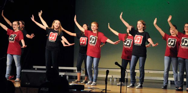Region Girls Choir members perform during the McCullough Junior High choir's pop concert at the Nancy Bock Center of the Performing Arts auditorium.