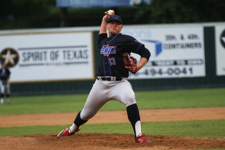 Oak Ridge's Luken Baker (33) throws a pitch during the high school baseball game against Conroe back in April.