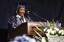 Student body president Sydney Bell speaks during the College Park graduation on Monday at the Cynthia Woods Mitchell Pavilion.