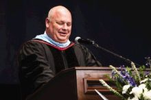 Principal Mark Murrell speaks during the College Park graduation on Monday at the Cynthia Woods Mitchell Pavilion.