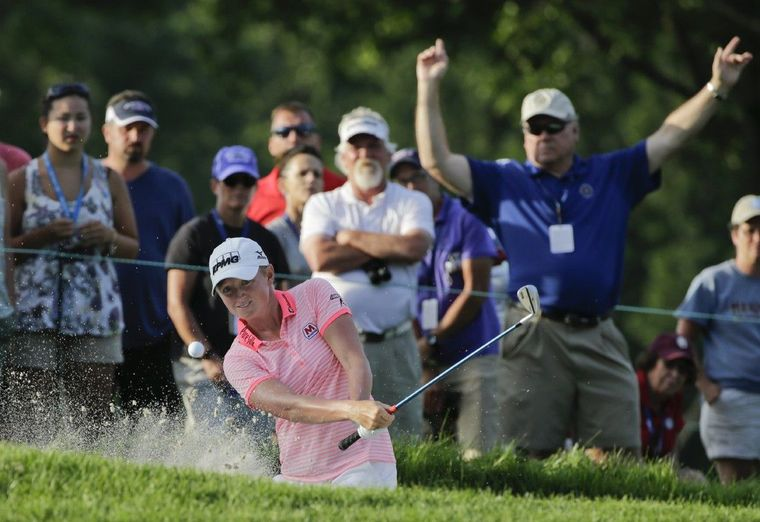 Stacy Lewis hits out of a bunker on the ninth hole during the second round of the U.S. Women's Open golf tournament at Lancaster Country Club, Friday in Lancaster, Pa.
