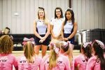 The new cheer coach for The Woodlands Christian Academy, Janel Jackson, center, speaks with cheerleaders during a summer camp on July 27 with Presley Wilson, right, and Haley LeBlanc, right, of the Universal Cheerleaders Association.