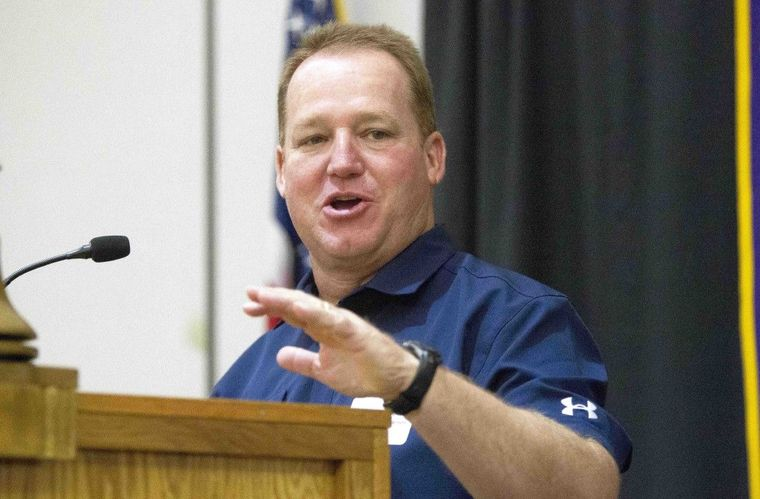 College Park head coach Richard Carson speaks during the annual Pigskin Preview at the Noon Lions Club meeting Wednesday.