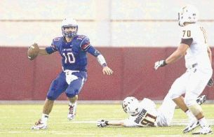 Oak Ridge quarterback Braden Letney looks for a receiver against Deer Park last season. The War Eagles will face Deer Park on the road Friday night.