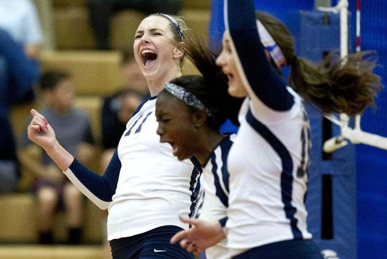 College Park celebrates after winning the first set during a volleyball game against Oak Ridge Tuesday.