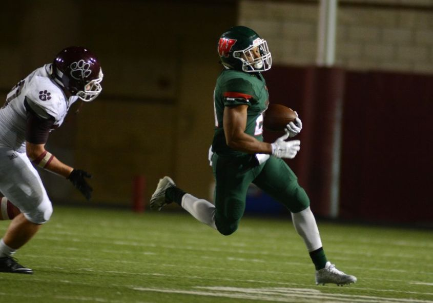 The Woodlands senior defensive back Antoine Winfield Jr., right, outruns a Cy-Fair defender on a punt return during the season opener.
