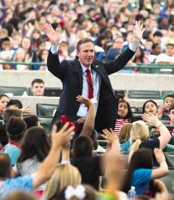 Conroe ISD superintendent Don Stockton waves to students during Fine Arts Education Day featuring the Houston Symphony at Cynthia Woods Mitchell Pavilion Wednesday