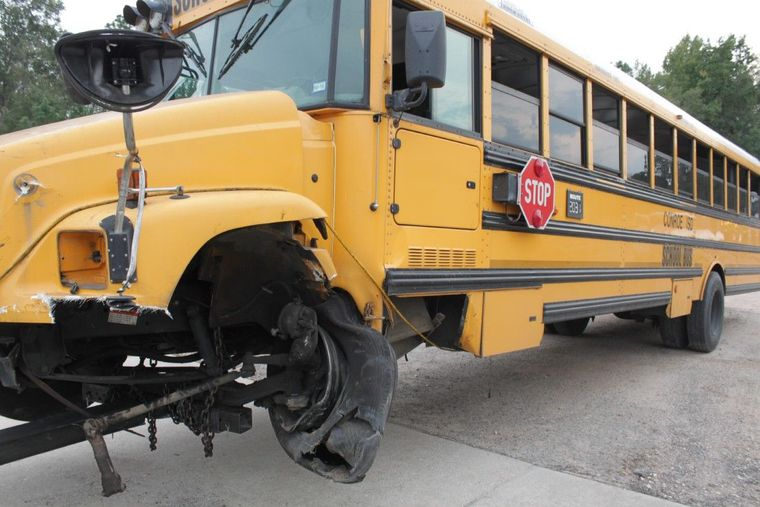 A Conroe ISD school bus is hauled away by a tow truck after being involved in a crash on FM 1314.