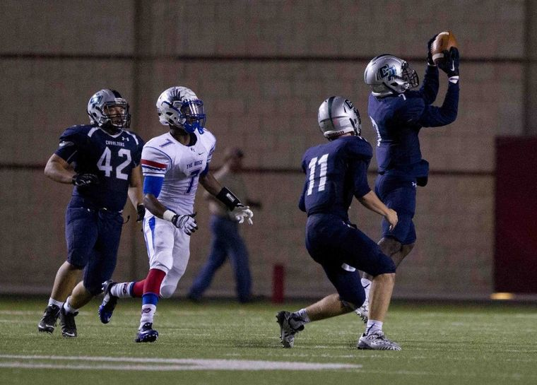 College Park defenisve back Kaleb Taylor intercepts a pass from quarterback Braden Letney in the fourth quarter of a football game Friday.