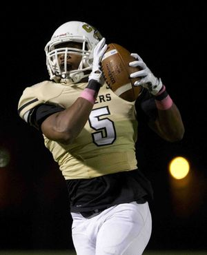 Conroe wide receiver Kameron Williams catches a pass during a football game Friday against Kingwood.