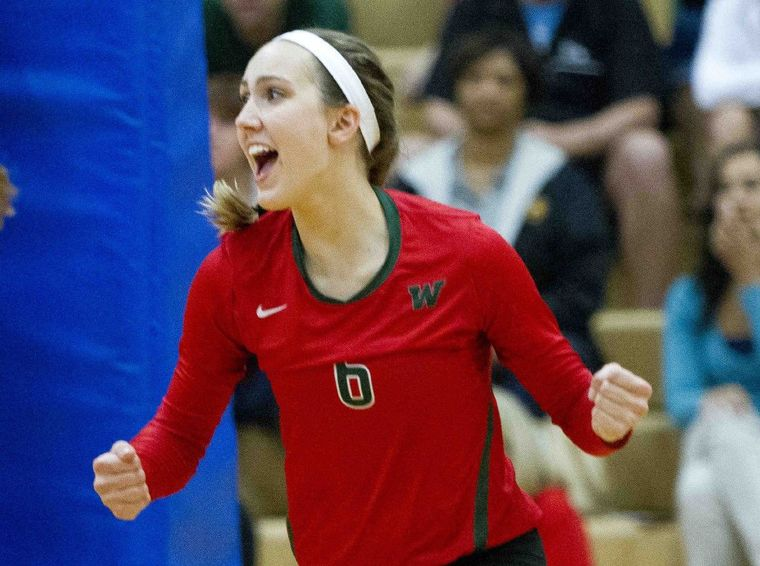 The Woodlands' Courtney Heiser celebrates a point during a volleyball game Tuesday.