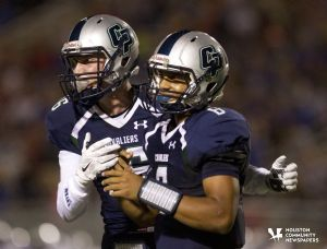 College Park wide receiver Nick Brown, left, celebrates with quarterback Jordan Turnquest after a touchdown in the first half of a football game Friday.