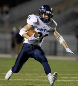 Kingwood's Griffin Lay runs for a first down during a District 16-6A football game Friday.