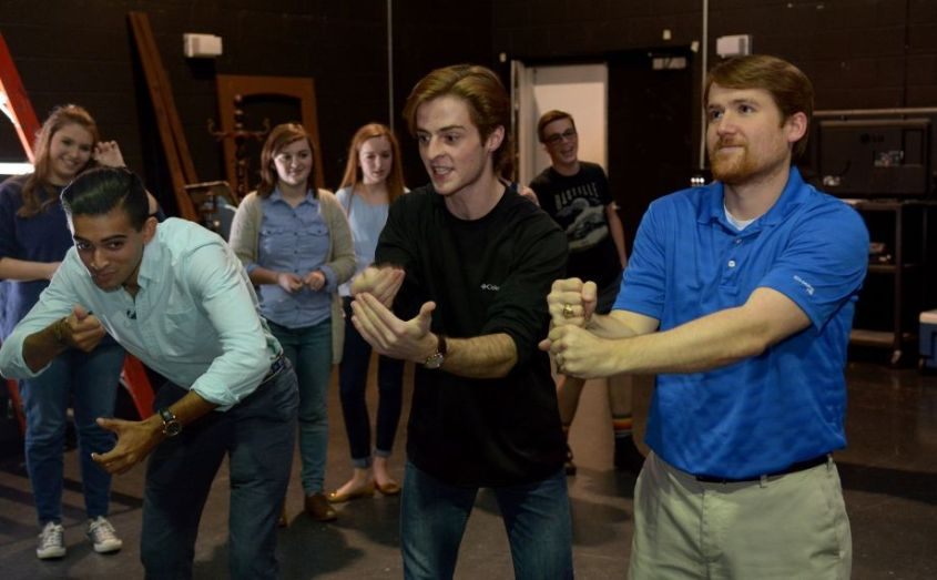 The Woodlands High School Improv Troupe members Omar Saber, 17, from left, and Will Burke, 18, both seniors, work with TWHS Theater Director Matthew Peters during a rehearsal in the school's black box theater