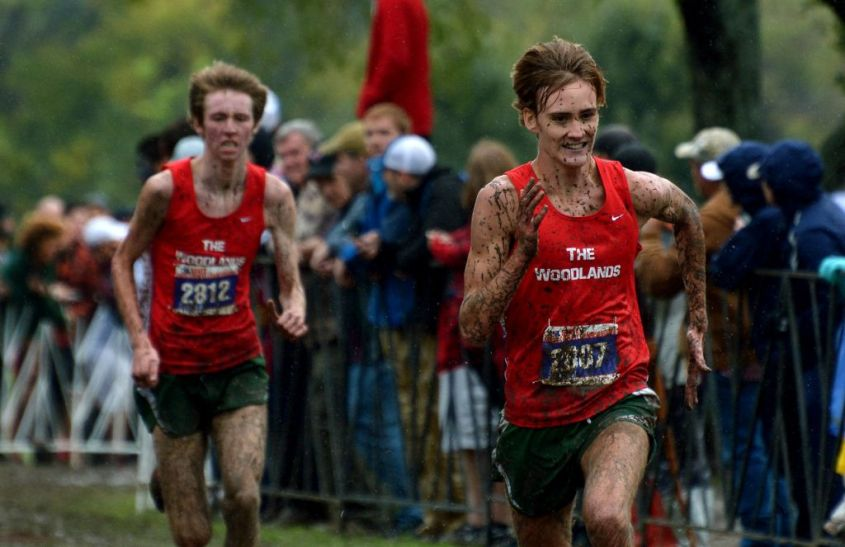 The Woodlands senior Daniel Golden, right, and junior teammate Noah Wells push to the finish line for their 1st and 2nd place finishes in the Boys Conference 6A race at the 2015 UIL Texas State Cross Country Championships at Old Settlers Park in Round Rock on Saturday, Nov. 7, 2015.