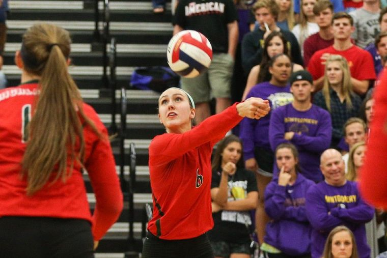 The Woodlands' Courtney Heiser hits the ball against Montgomery.
