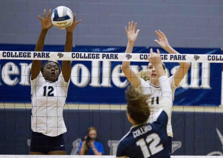 College Park's Linzy Woods blocks a shot by Klein Collins' Kelly Farina at College Park High School Tuesday.
