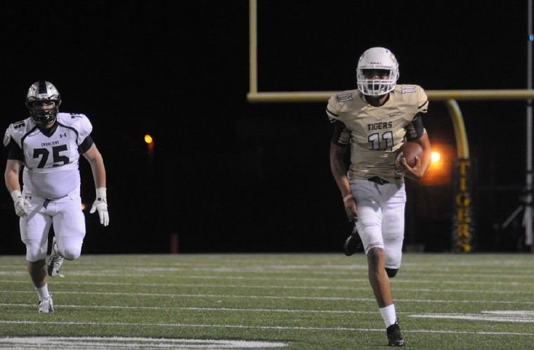 Conroe's Colby Kizzie runs for a first down against College Park on Friday at Moorhead Stadium.