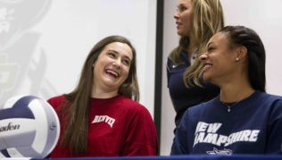 Volleyball player Hannah Erwin laughs with Kennedi Smith during a college signing celebration for atheltes at College Park High School Wednesday. Erwin plans to play volleyball for the University of Denver, while Smith will play for the University of New Hampshire.