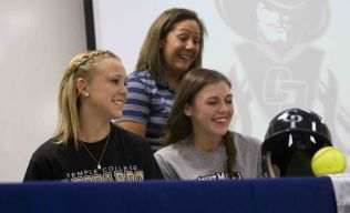 Softball players Julie French and Jordan Green laugh during a college signing celebration for atheltes at College Park High School Wednesday. French will play for Mount Mary University, while French will play for Temple College.