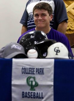 Aric Wilson signed to play baseball for Abilene Christian University during a college signing celebration for atheltes at College Park High School Wednesday.