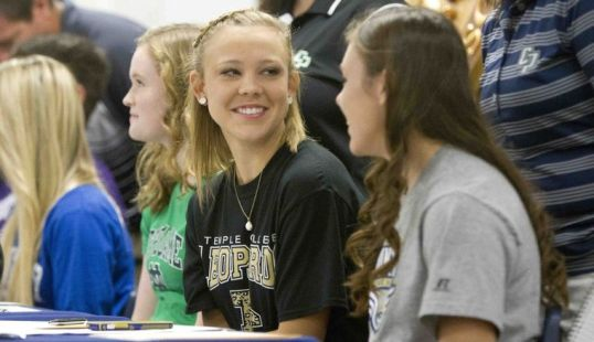 Softball players Julie French, left, and Jordan Green talk during a college signing celebration for atheltes at College Park High School Wednesday. French signed with Temple College, while Green with sign with Mount Mary University.