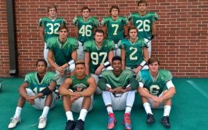 Members of The Woodlands defense pose for a picture before Tuesday's practice. Front row (from left), defensive backs A.J. Mason, Antoine Winfield, Talon Baskin and Connor Binney; second row (from left), linemen Michael Purcell, Grant Stephens and Christian Cargill; and back row (from left), linebackers Matt Mahoney, Eugene Bizer, Ian Harris and Cole Sichley.