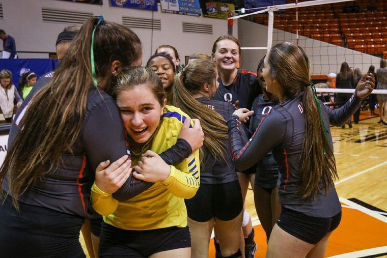 Oak Ridge's Carly Graham (11) embraces teammate Raigen Cianciulli after the Lady War Eagles' victory over The Woodlands in the Region II-6A tournament on Saturday in Huntsville.