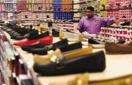 Store Manager Sam Arredondo checks inventory at Rack Room Shoes in the business' new location in The Woodlands off I-45 South and Lake Woodlands Dr. on the day of the store's grand opening.