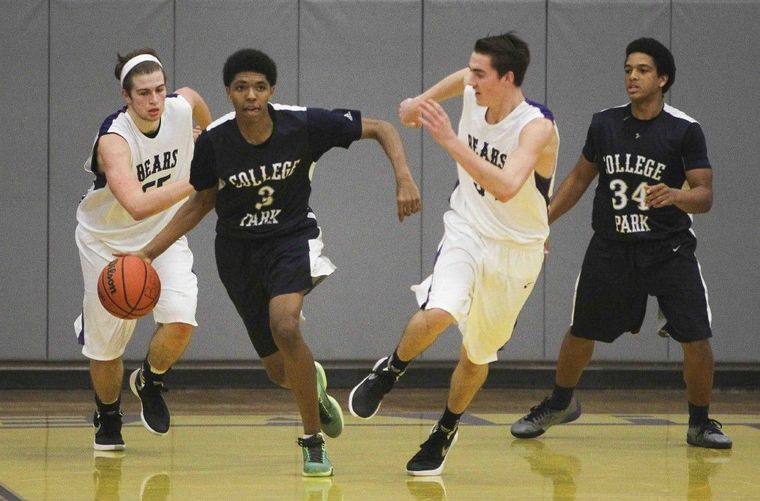 College Park's Quincey Trammell starts a fast break during a high school basketball game Tuesday in Montgomery.