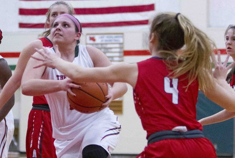 The Woodlands guard Julia Glandt drives toward the basket during a high school basketball game Tuesday, Nov. 24, 2015, in The Woodlands.