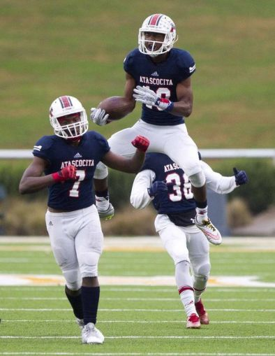 Atascocita defensive back Justen Campbell celebrates after intercepting a pass against Rowlett in the Class 6A Division I regional playoffs on Saturday in Waco.