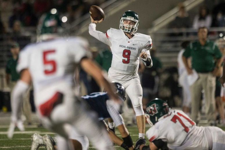 The Woodlands quarterback Harry Woodberry (9) fires a 21-yard touchdown pass to Reed Barber in the third quarter against Kingwood at Turner Stadium.