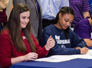 Hannah Erwin and Kennedi Smith sign their letters of intent at College Park's Signing Day Ceremony.