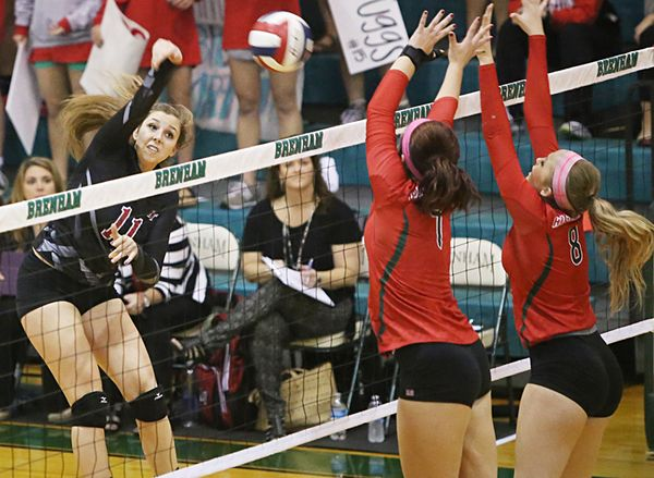 Leah Mulkey (11) goes for a point against The Woodlands in Lake Travis' Class 6A, Region II quarterfinal in Brenham Tuesday, Nov. 10, 2015.